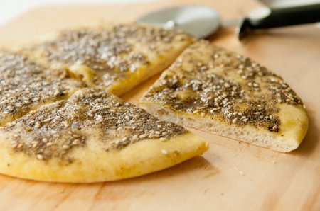 za'atar flat bread, a lebanese or turkish bread made with sumac, sunflower seeds and thyme with olive oil on top.