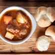 Постер, плакат: Lamb stew with cloverleaf buns
