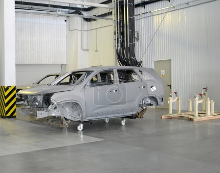 The bodies of cars prepared for painting. Shop of automobile pla