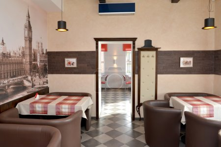 Interior of modern cafe in brown tones. Stylization under the Lo