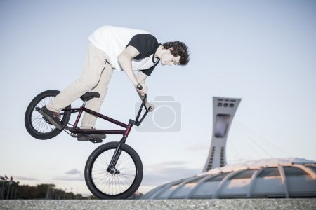 Bmx rider performing a nose manual
