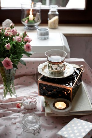 Romantic tea time settings with candles and roses