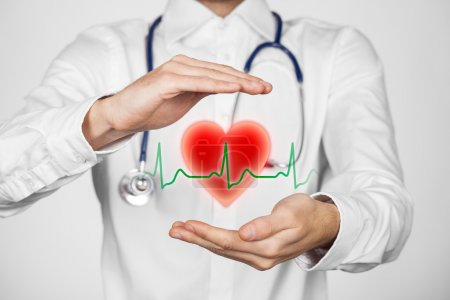 Photo for Protect health (healthcare) and heart problems prevention (cardiology) concept. Cardiologist with protective gesture and symbol of heart and ECG heartbeat - Royalty Free Image