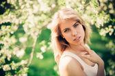 Springtime portrait of woman in park.