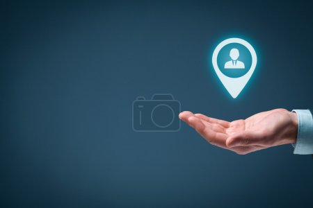 Photo for Target customer and human resources concept. Man holding target customer, employee in hand - Royalty Free Image