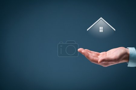 Photo for Property insurance and real estate agent concept. Care gesture of man and symbol of house - Royalty Free Image