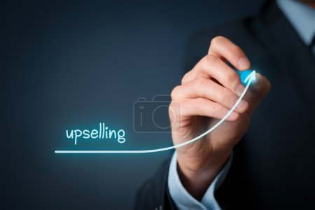 Photo for Upselling on-line (e-shop) marketing concept. Sales technique for more profitable sale. Businessman draw growing profit graph thanks upselling - Royalty Free Image