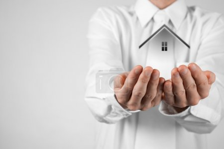 Photo for Real estate agent offer house. Property insurance and security concept. White background - Royalty Free Image