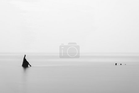 Photo for Landscape minimalist image of shipwreck ruin in sea black and white - Royalty Free Image