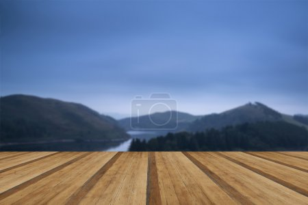 Moody landscape image of lake pre-dawn in Autumn with haunting f