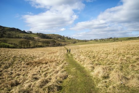 Photo for Unidentified hikers in landscape in Peak District in UK - Royalty Free Image