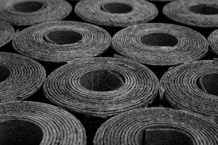 rolls of roofing felt