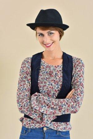 trendy girl in  hat standing