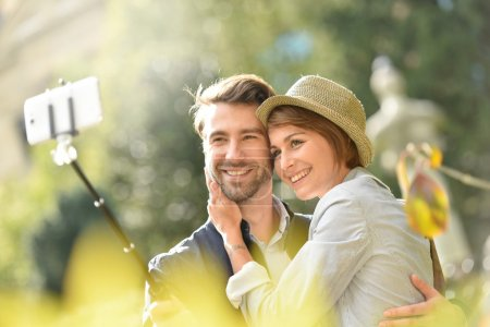 couple taking selfie picture with smartphone