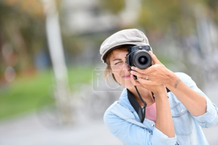 Photo for Young woman photographer on a shooting day in town - Royalty Free Image