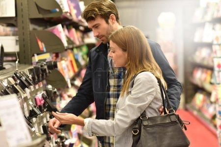Couple choosing smartphone