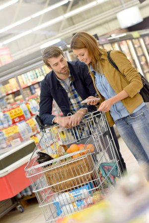 Couple in supermarket doing  shopping