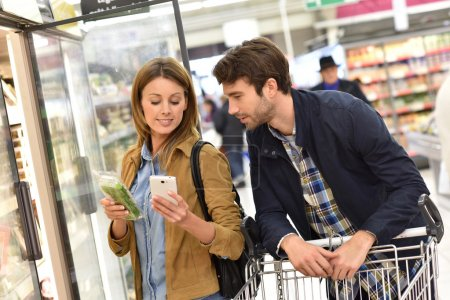Couple reading shopping list
