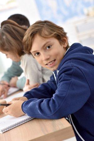 school boy in class
