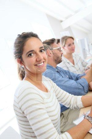 brunette school girl in class
