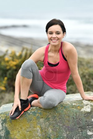 Woman in fitness outfit relaxing