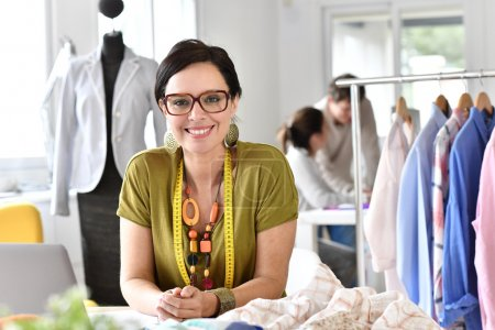 Photo for Portrait of cheerful trendy fashion designer smiling - Royalty Free Image