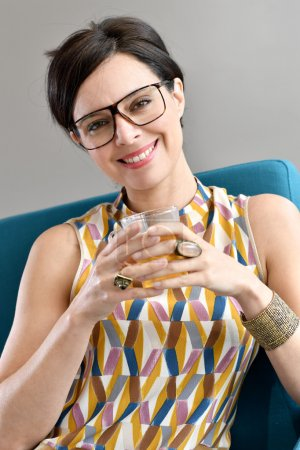 Trendy woman having tea