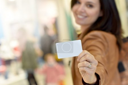 Photo for Portrait of woman holding card in shopping mall - Royalty Free Image