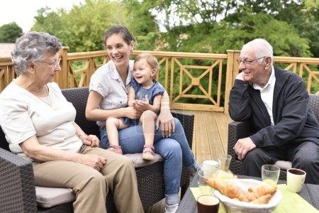 Granddaughter visiting grand-parents