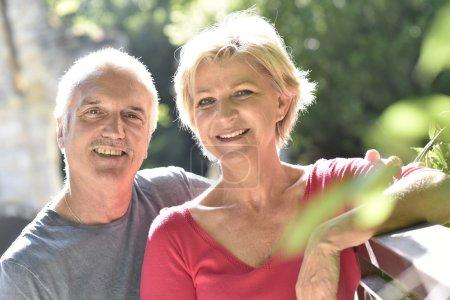 senior couple in garden posing
