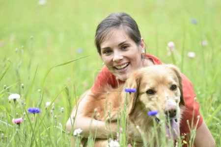Cheerful woman with dog sitting