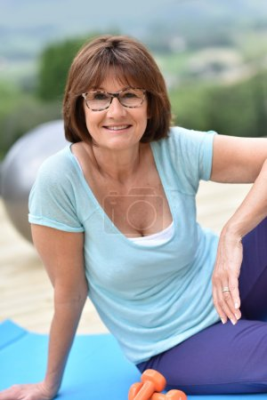 smiling woman with dumbbells