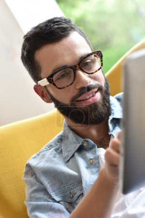 guy  using digital tablet