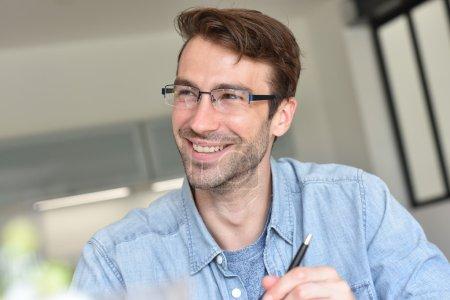 guy with eyeglasses  sitting