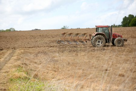 Tractor running in agricultural field