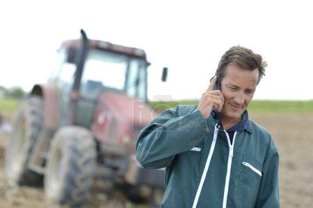 Farmer talking on mobile phone