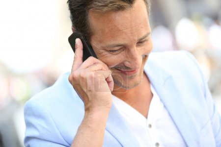Mature man talking on phone