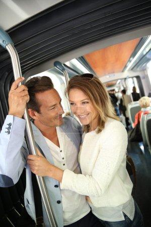 People in town taking public transportation