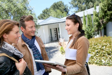Couple meeting real-estate agent