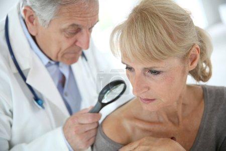 Doctor check on beauty spot