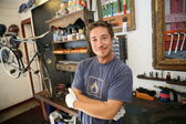 Smiling business owner in bicycle shop