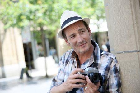 Photographer doing photo reportage