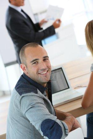 Man attending management training class