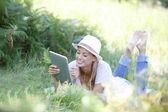 Woman using digital tablet in field
