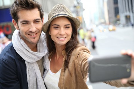 Couple taking picture with smartphone