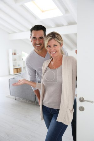 Mature couple standing at home