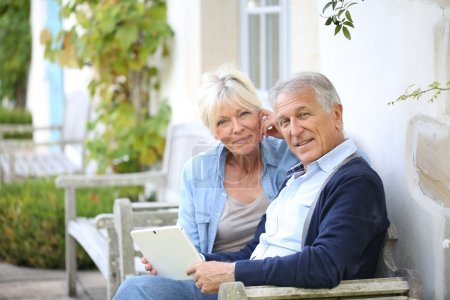 Senior couple websurfing on internet