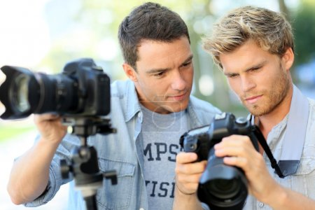 Photo for Young men on a photography training day - Royalty Free Image