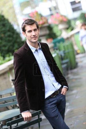 Businessman standing in city steet