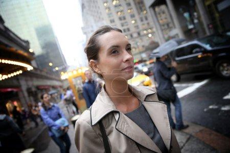 Businesswoman in Manhattan on raining day